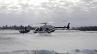 Bell 407 GX Landing In Fresh Snow At A Womans Day Air Show